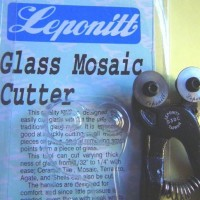"""BEST QUALITY - LEPONITT (and most popular mosaic cutter)  Leponitt's G30C - Mosaic Tile TWO WHEEL Cutter  FOR working with BROKEN CHINA, CERAMIC TILE & GLASS  Ideal for cutting small Mosaic Pieces (Instructions included in package) ~*~ ALSO 3rd PICTURE in this listing tells you how to use this!  Can cut varying thickness of glass from 1/32"""" to 1/4"""" with ease; Ceramic Tile, Mosaic, Terrazzo Agate, & Shells can also be cut.  The handles are designed for comfort & since little pressure is needed, even those with weak wrists will find it very easy to use.  Jaws open full 9/16""""  Long lasting carbide wheels are 7/8"""" diameter  All STEEL construction with spring return to full opening.  Non-slip plastic hand grips.  I sell the replacement wheels as well so you never have to buy another Cutter!"""
